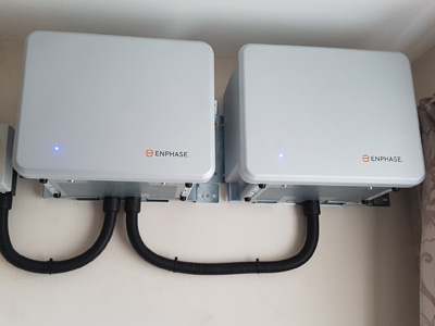 2 Enphase Energy AC batteries on kitchen wall