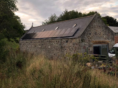Stone house with solar panels