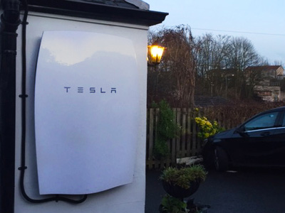 Tesla Powerwall battery on wall