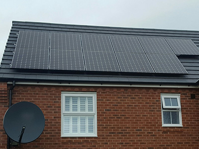 Black panel Solar PV installation on slate roof